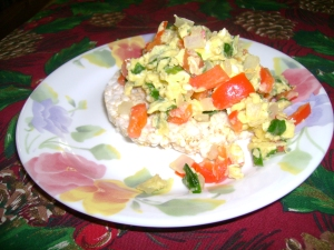 Healthy breakfast includes eggs, veggies and a rice cake, yummm!!!
